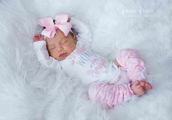6a5043b5588b What I love about this baby girl coming home outfit | The pink legwarmers-  Can't get much cuter than that!